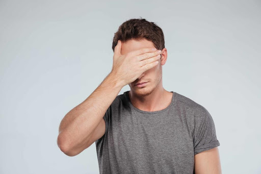 Facepalm - Man with grey T-shirt suffering feelings of shame and guilt – Dr. Dadson can help